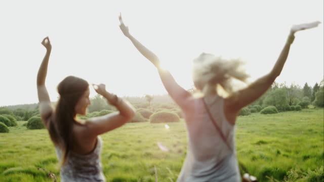 Women cheering outdoors on roadtrip video