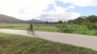 Women cycling on country road video