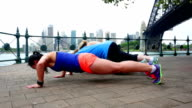 Women Doing Pushups and the Plank by Sydney Harbour video