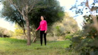 women doing streching exercising in the nature video