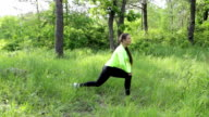 Women doing stretching exercising in the nature video