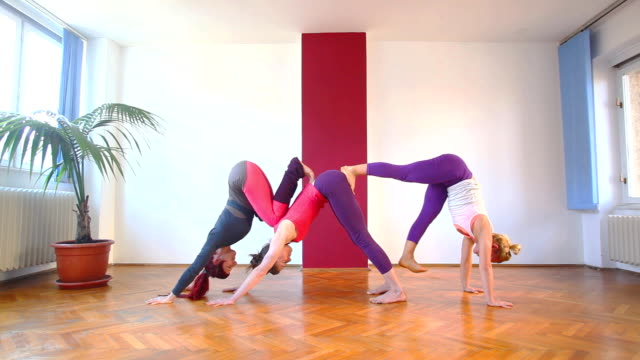 Women doing yoga class in hall video