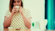 women drink coffee at coffee cafe. video
