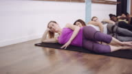 Women exercising in a line video
