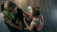 Women friends talking in gym video