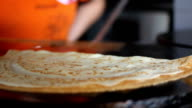 Women frying and flip pancakes at professional griddle video