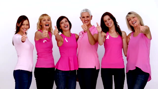Women giving thumbs up for breast cancer awareness video