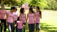 Women going on a walk for breast cancer awareness video