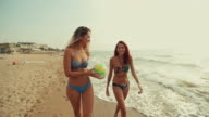 Women going to play beach volley and have fun video