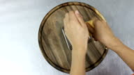 women hand grating the cheese with a metal grater. top view video