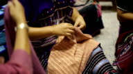 women hand sewing video