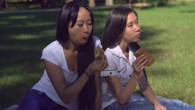 Women have breakfast outdoors video