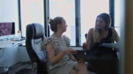 Women Helping Each Other in Office video
