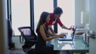 Women Helping One Another in Office video