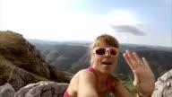 Women hiker making a video call to friend video