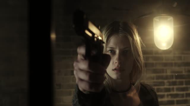 Women holding a gun video