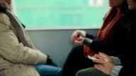 Women in a train, traveling together video