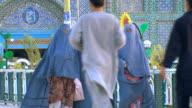 Women in burkha outside mosque, Afghanistan. video