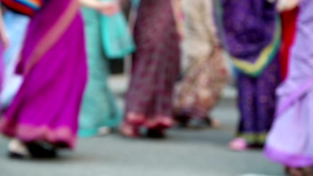 Women in Hindu traditional colorful costumes, dancing on the street video