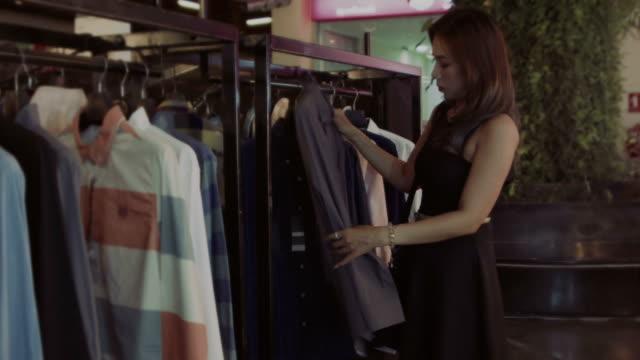 women in shopping mall video