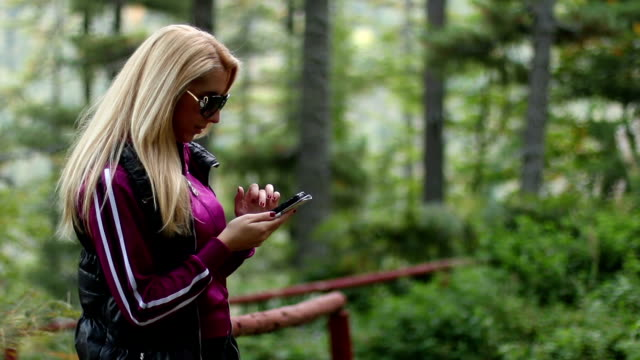 Women in Sports Equipment writes on her mobile video
