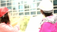 Women in STEM - engineer or architect team working on a construction project in city. video