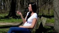 Women in the park with a cigarette video