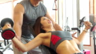 Women is exercising with trainer video