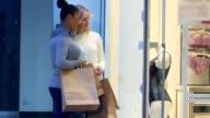 Women look at underwear through the store window video
