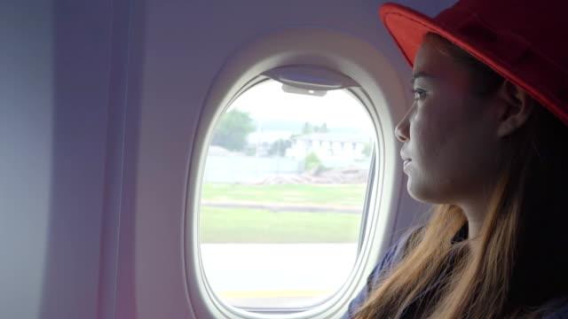 Women looking at Airplane Window video