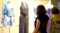 Women Looking at Shop front video