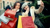 Women make a selfie during shopping video