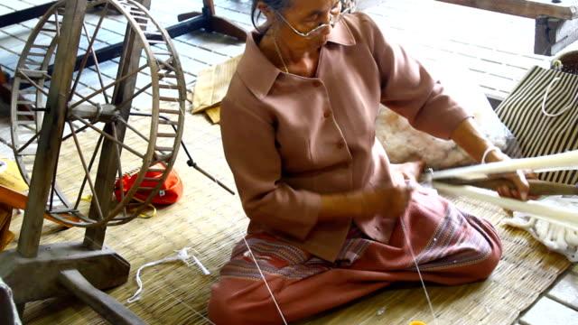Women make thread for weaving ,Thailand video