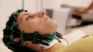Women on EEG examination in clinic,close up video