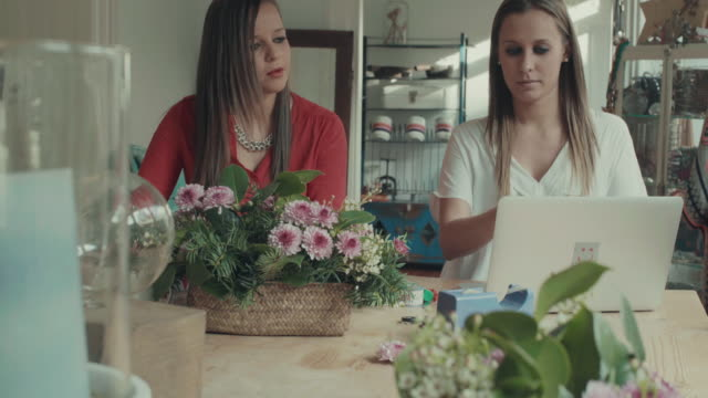 Women online shopping in the startup office video