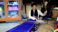Women Pa-Ka-Geh-Yor (Karen Sgaw) in Tribal dress was weaving. video