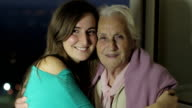 Women portrait with happy grandmother and granddaughter smilingshowing love video