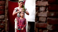 Women preparing child in the morning video