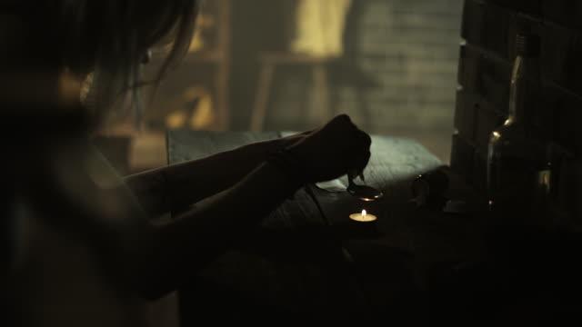 Women preparing heroin for use video