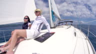 WS Women Relaxing On A Sailboat video