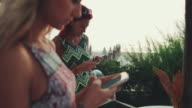 Women relaxing together during aperitif by the sea video