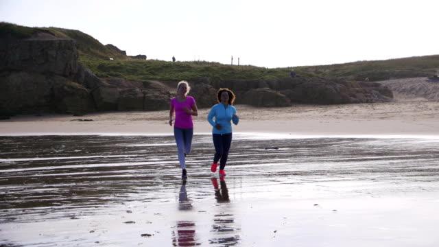 Women Running along the Beach Together video