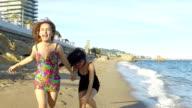 Women running on the beach. Slow motion video