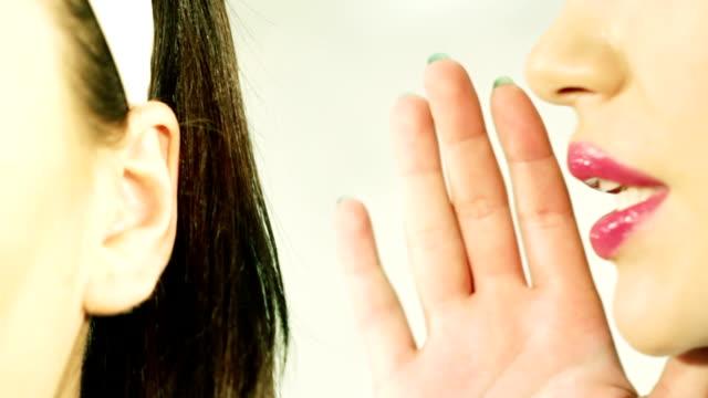 women said, woman listening to gossip video