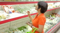 Women shopping fruits and vegetables in supermarket video