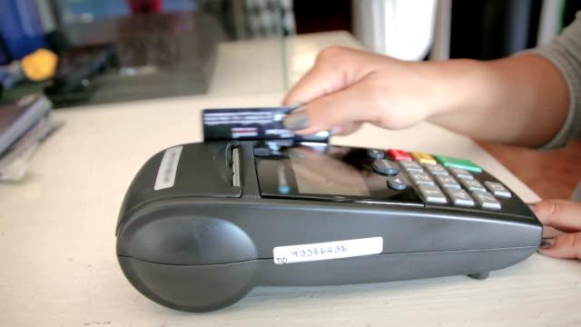 Women Swiping A Credit Card,Dolly Shot video