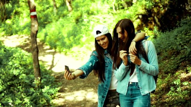 Women taking selfie in forest video