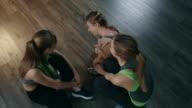 Women talking in gym video
