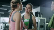 Women talking in gym video