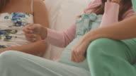 Women talking on baby shower video
